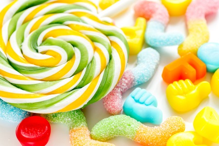 lollipop design with sugar candys on sweet texure abstract background