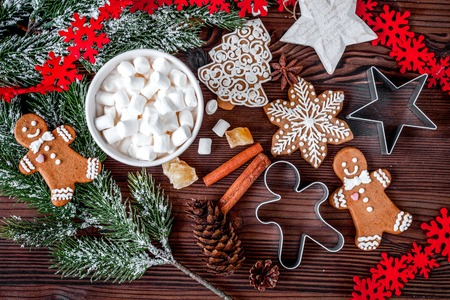 Foto de Christmas gingerbread, spruce branches on dark wooden background - Imagen libre de derechos