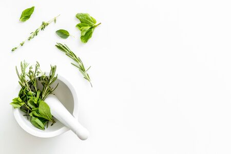 Homeopathy. Healing herbs for medicine on white background top view mockup