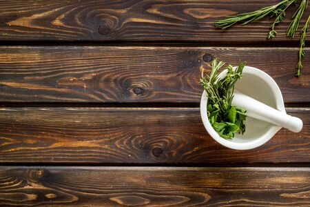 Healing herbs for medicine on wooden background top view mockup