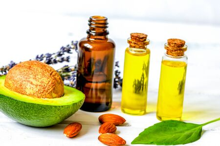Foto de avocado oil for handmade cosmetics with herb on wooden background - Imagen libre de derechos