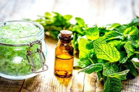 Foto de organic cosmetics with herbal extracts of mint on wooden background. - Imagen libre de derechos