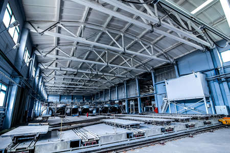 Photo pour factory premises with opened autoclaves for concrete blocks production with rail and trolley panoramic view - image libre de droit