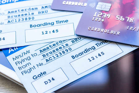 Photo pour Credit cards with airline tickets for vacations on table background - image libre de droit