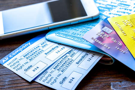 Photo pour Buying airline tickets online with credit cards on table background - image libre de droit