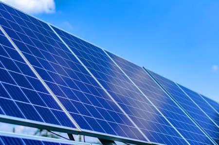 Photo pour Solar panels on blue sky background - image libre de droit