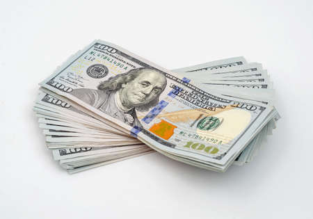Photo pour Stack of american dollars. Close-up on a white background - image libre de droit