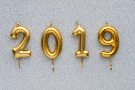 Foto de Marry Christmas and happy New Year 2019 layout. Gold candles numbers 2019 - Imagen libre de derechos