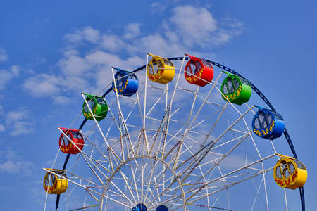 Photo for Part of a ferris wheel with round cabins decorated with ornaments - Royalty Free Image
