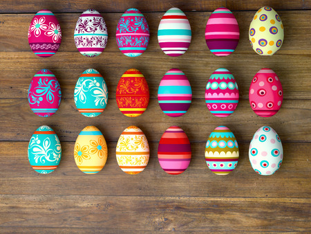 Easter eggs on wooden table background with copy space