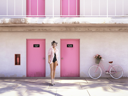 Foto de woman walking from abandoned motel with pink doors. vacation concept - Imagen libre de derechos