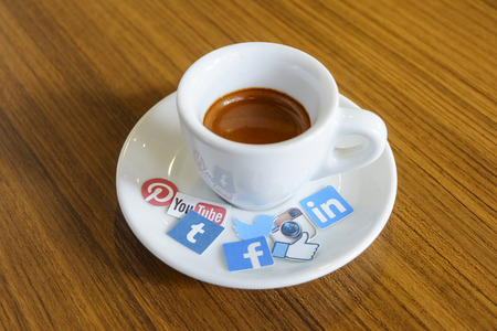 Photo for CHIANG MAI, THAILAND - SEPTEMBER 24, 2014: Social media brands printed on sticker and placed on hot coffee cup morning life. - Royalty Free Image