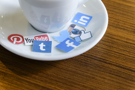 CHIANG MAI, THAILAND - SEPTEMBER 24, 2014: Social media brands printed on sticker and placed on hot coffee cup morning life.