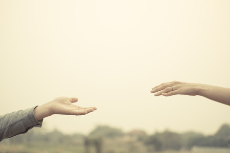 Photo for Couple hand together touch with love vintage filter tone. - Royalty Free Image
