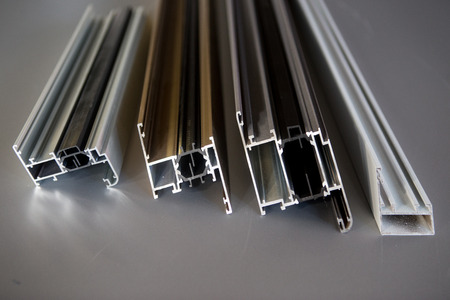 Photo for protruded aluminum profile for windows and doors manufacturing .selective focus - Royalty Free Image