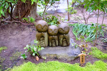 Photo for Jizo sculpture doll (little Japanese Buddhist monk doll rock) in Japanese Garden - Royalty Free Image