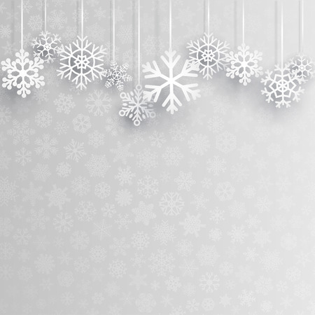 Christmas background with several hanging snowflakes on gray background of small snowflakes