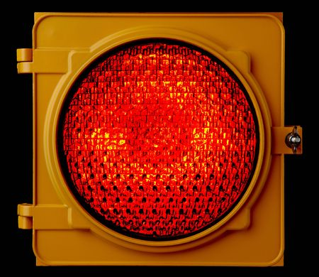 Close up of illuminated red traffic light lens