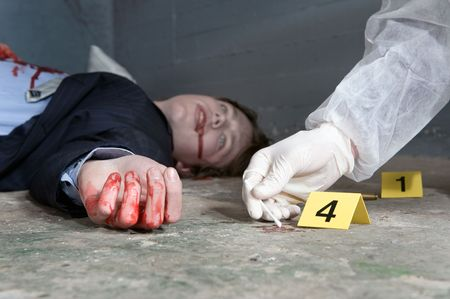 Forensic expert collecting evidence at the crime scene of a murdered businessman