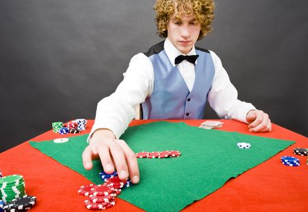 A dealer paying out a player after a winning a game