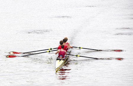 Coxed four rowing towards the camera, on a bleak day in open water