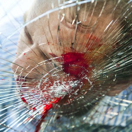 Photo pour Pedestrian hit by a car, with blood on the splintered windshield - image libre de droit