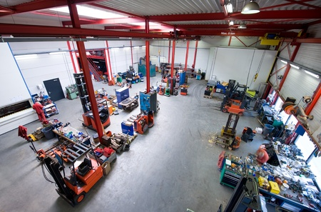 An overview of the interior of a forklift workshop viewed from above.