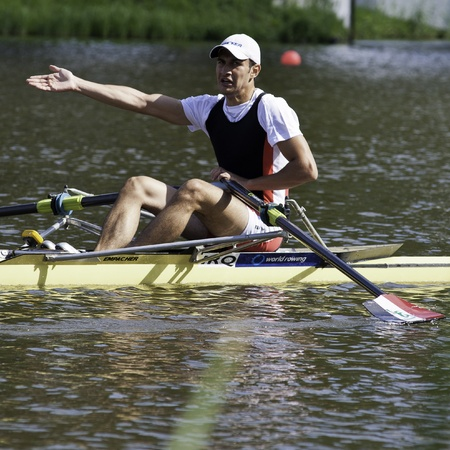 Bosbaan, Amsterdam, the Netherlands - 22 July 2011:  Iraqi single sculls rower Ahmed Haily complains after the finish of his race, finishing 5th in the quarter finals of the world championships under 23