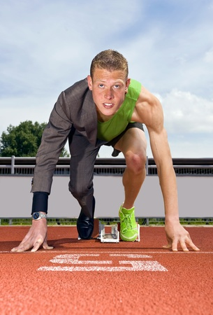 Conceptual image of an athlete (sprinter) ready to start a business career. Performane in business is top sport