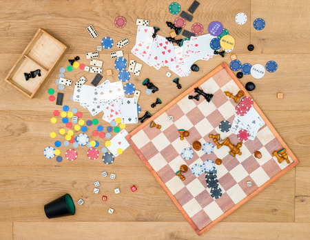 Directly above shot of various leisure games spread on wooden table