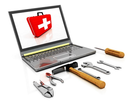 Photo pour The monitor with the complete set of tools for repair - image libre de droit