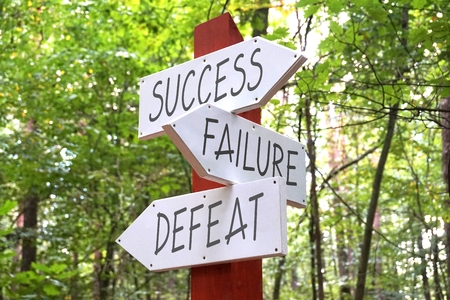Success, failure, defeat - signpost: Royalty-free images