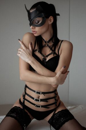 Photo for Image of playful catwoman posing looking at camera - Royalty Free Image