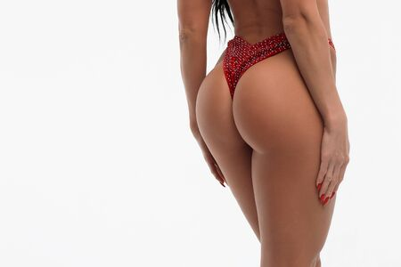 Foto de Back view of crop sexual woman with perfect body in red bikini isolated on white background - Imagen libre de derechos