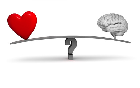 A bright, red heart and gray brain sit on opposite ends of a dark gray board balanced on a gray question mark. Isolated on white.
