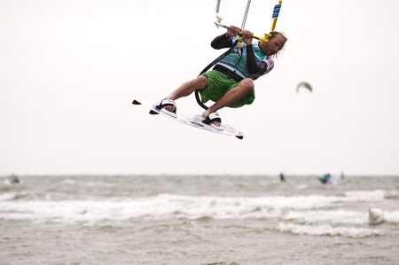 ST. PETER-ORDING, GERMANY - JULY 22: Professional  kite-surfer Dennis Leuthold, Germany,  demonstrating his ability on the Palmolive Kitesurf Worldcup 2010 in St. Peter-Ording, July 22, 2010 in St. Peter-Ording, Germany