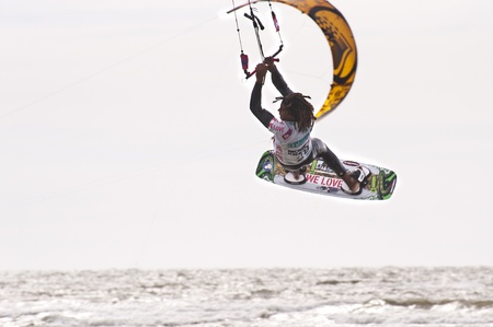 ST. PETER-ORDING, GERMANY - JULY 22: Professional  kite-surfer Emmanuel Norman, Germany,  demonstrating his ability on the Palmolive Kitesurf Worldcup 2010 in St. Peter-Ording, July 22, 2010 in St. Peter-Ording, Germany