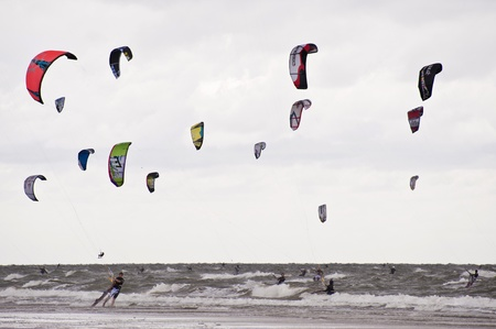 ST. PETER-ORDING, GERMANY - JULY 24: Professional kite-surfers demonstrating their ability on the Palmolive Kitesurf Worldcup 2010 in St. Peter-Ording, July 24, 2010 in St. Peter-Ording, Germany