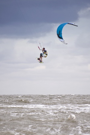 ST. PETER-ORDING, GERMANY - JULY 24: Professional kite-surfer demonstrating his ability on the Palmolive Kitesurf Worldcup 2010 in St. Peter-Ording, July 24, 2010 in St. Peter-Ording, Germany