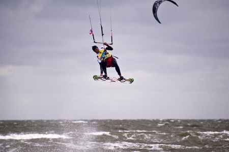 ST. PETER-ORDING, GERMANY - JULY 24: Professional kite-surfer Gunnar Biniasch, Germany, demonstrating his ability on the Palmolive Kitesurf Worldcup 2010 in St. Peter-Ording, July 24, 2010 in St. Peter-Ording, Germany