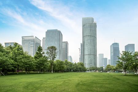 Photo pour Grassland and modern architecture - image libre de droit