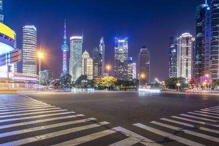 Photo pour Highway zebra crossing and building landscape night view - image libre de droit