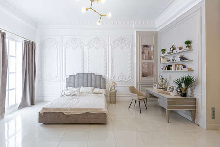 Photo for chic luxury interior in an old antique style open-plan apartment decorated with columns and stucco on the wall in pastel colors. tiles on the floor. beige walls - Royalty Free Image