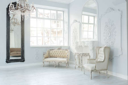 Photo for Luxury rich living room interior design with elegant classic furniture and wall decorations. Large light white room with big window - Royalty Free Image