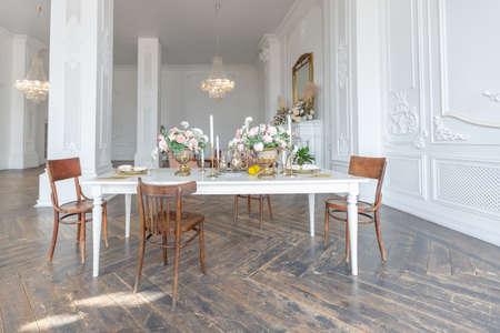 Photo for royal baroque style luxury posh interior of large room. extra white, full of day light. high ceiling and walls decorated by stucco - Royalty Free Image