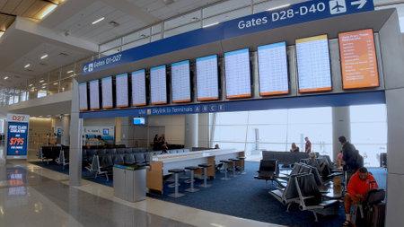 Foto für Departure Gates at Dallas Fort Worth Airport - DALLAS, TEXAS - JUNE 20, 2019 - Lizenzfreies Bild