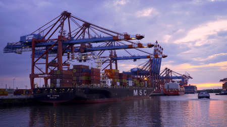 Photo pour Sunset over the port of Hamburg - HAMBURG CITY, GERMANY - MAY 10, 2021 - image libre de droit