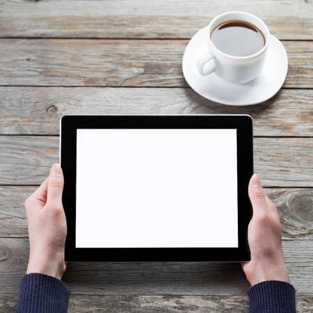 Foto de male hands holding digital tablet computer with isolated screen over cafe background - Imagen libre de derechos