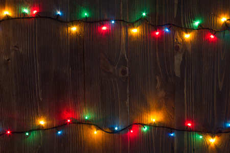 Christmas background. planked wood with lights and free text space