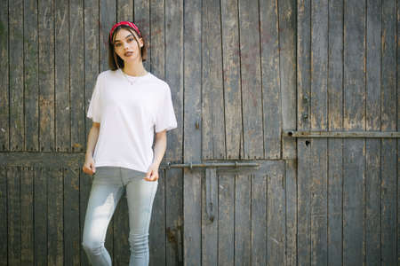 Photo pour Woman or girl wearing white blank t-shirt with space, mock up or design in casual urban style - image libre de droit